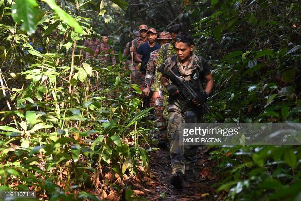 Members of a rescue team take part in a search effort to locate missing 15yearold FrancoIrish teenager Nora Quoirin on Mount Berembun Seremban on...