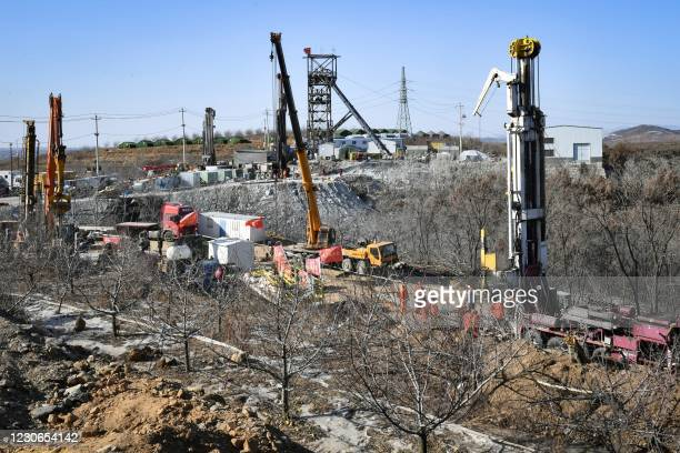 Members of a rescue team work at the site of a gold mine explosion where 22 miners are trapped underground in Qixia, in eastern China's Shandong...