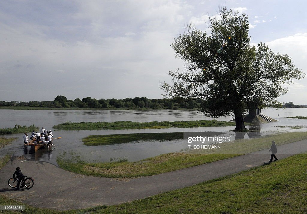Members of a rowing club from Berlin prepare to make a trip on the flooding Oder river in Ratzdorf near the Polish-German border on May 24, 2010. Public authorities expect the highest level of the flood wave to come to Germany on Wednesday or Thursday. Floods sweeping across Poland have killed 10 people in the past week, and caused damage estimated at more than 2.4 billion euros (3.2 billion dollars).