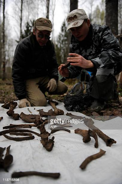 Members of a Russian team that looks for the remains of Red Army soldiers killed while fighting against Nazi Germany's forces during World War II...