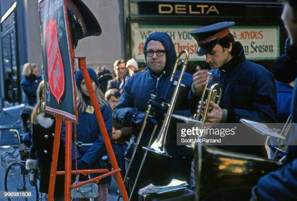 Members of a Salvation Army band as they perform with brass instruments for onlookers during the Christmas season at Rockefeller Center New York New...