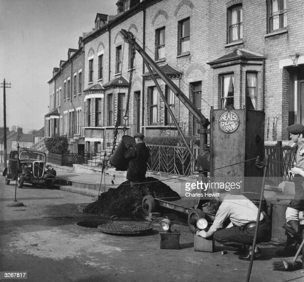 Members of a sewer gang at work in the streets of London keeping the drainage system of the city in working order Workers are employed at an average...