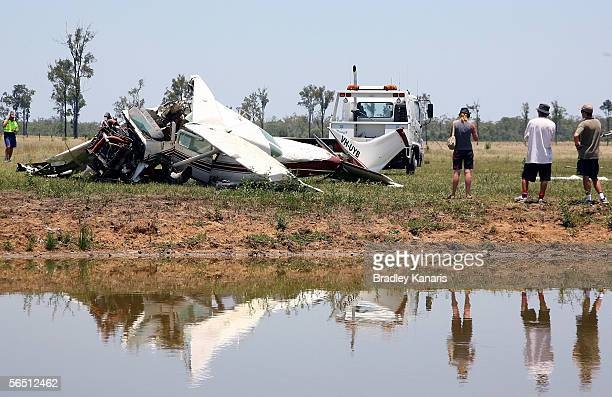 Members of a skydiving team pay their respects at the site of a crashed Cessna 206 January 3 2006 in Ipswich Australia The aircraft crashed into a...
