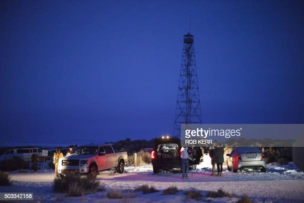 Members of a small militia at the entrance to the Malheur Wildlife Refuge Headquarters property some 30 miles from Burns Oregon January 3 2016 The...