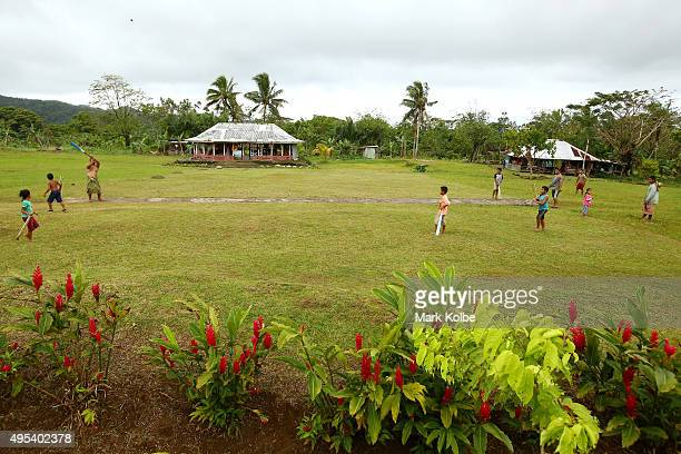 Members of a small village in the Atua district of the Upolu island play a game of cricket on September 12 2015 near Amaile Samoa