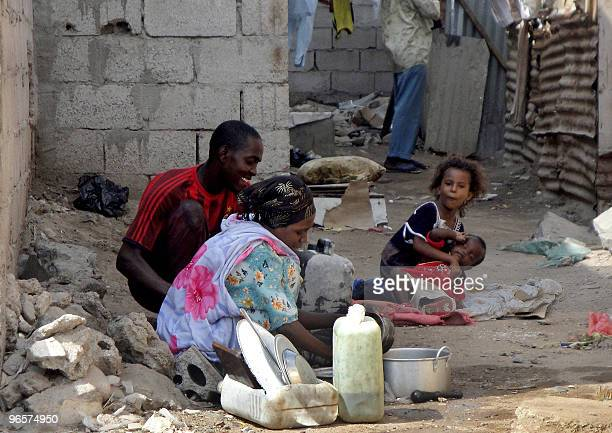 Members of a Somali refugee family sit in the Basateen slum near the Yemeni southern port city of Aden on February 11 2010 Hundreds of thousands of...
