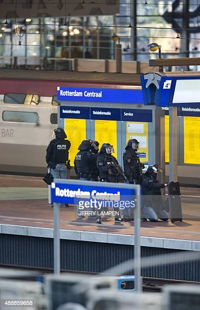 Members of a special unit of Dutch stand guard near a Thalys train on a platform of Rotterdam central station on September 18 as a man has locked...