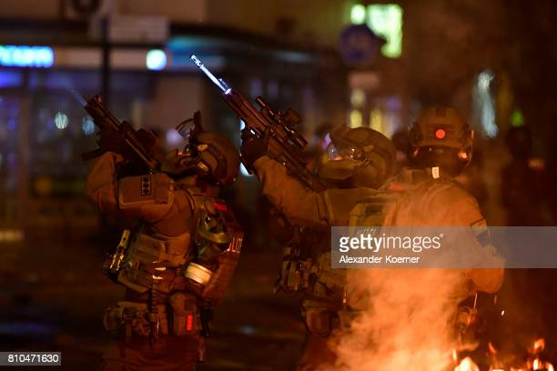 Members of a SWAT team hold machine guns while observing an apartment during an antiG20 protest on July 7 2017 in Hamburg Germany Authorities are...