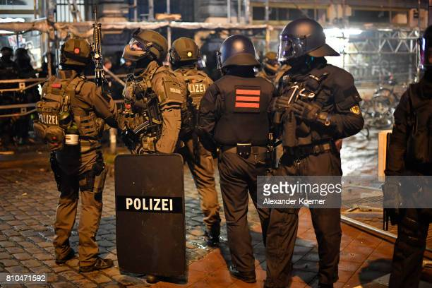 Members of a SWAT team move into the Schanze Area where protesters set up burning barricades and looters broke into stores during an antiG20 protest...