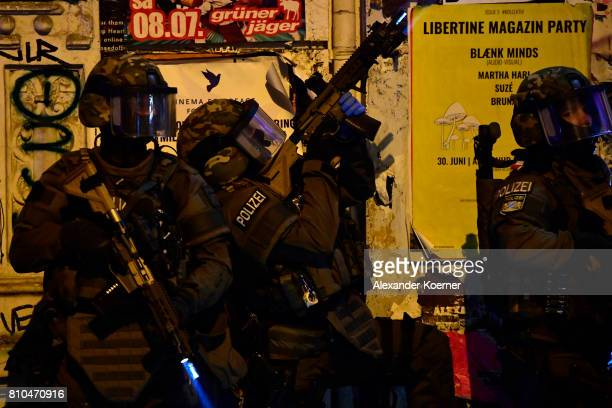 Members of a SWAT team observe an apartment used by protesters during an antiG20 protest on July 7 2017 in Hamburg Germany Authorities are braced for...