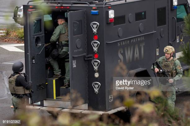 Members of a SWAT team work in a parking lot after a threat of an active shooter shut down campus at Highline College on February 16, 2018 in Des...