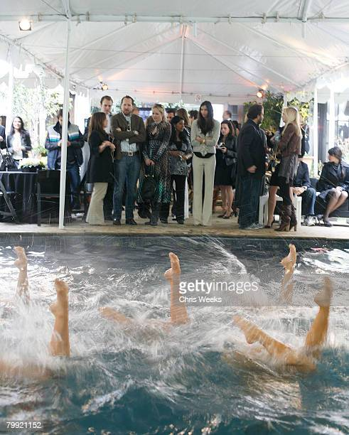 BEVERLY HILLS CA FEBRUARY 21 Members of a synchronized swim team perform at a luncheon hosted by legendary producer Robert Evans at a private...