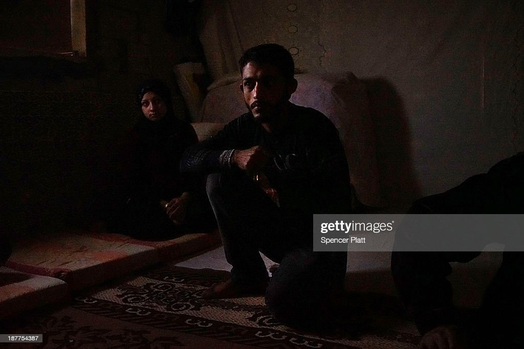 Members of a Syrian family sit inside of a room in a half finished house they are sharing with dozens of other refugees only miles from the border with Syria in the Bekaa Valley on November 12, 2013 in Majdal Anjar, Lebanon. As the war in neighboring Syria drags on for a third year, Lebanon, a country of only 4 million people, is now home to the largest number of Syrian refugees who have fled the conflict. The situation is beginning to put huge social and political strains on Lebanon as there is currently no end in sight to the war in Syria.