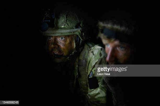 Members of a team from the British armed forces take part in Artillery Target and Emergency Close Air Support Procedures using simulation software at...