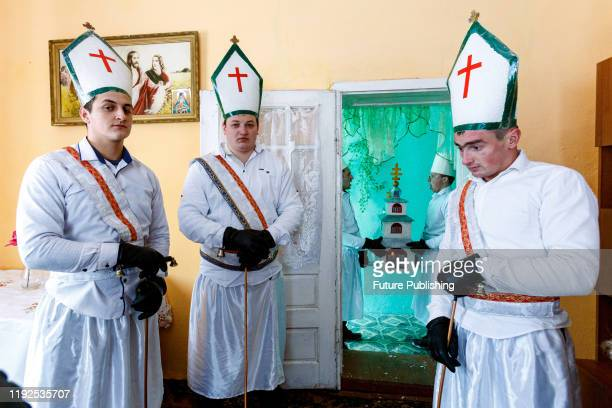 Members of a traditional vertep , known locally as the betlehem, visit one of the houses on Christmas Day, Polianska Huta village, Perechyn district,...