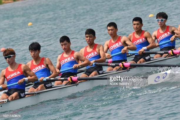 Members of a Unified Korean team compete in the men's lightweight eight repechages rowing event at the 2018 Asian Games in Palembang on August 22 2018