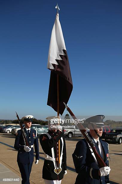 Members of a US military honor cordon march with the Qatari flag after the arrival of Qatar Minister of State for Defense Affairs Hamad bin Ali Al...