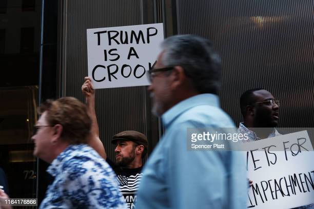 Members of a veterans group called Common Defense protest against President Donald Trump in front of Trump Tower on July 25, 2019 in New York City....