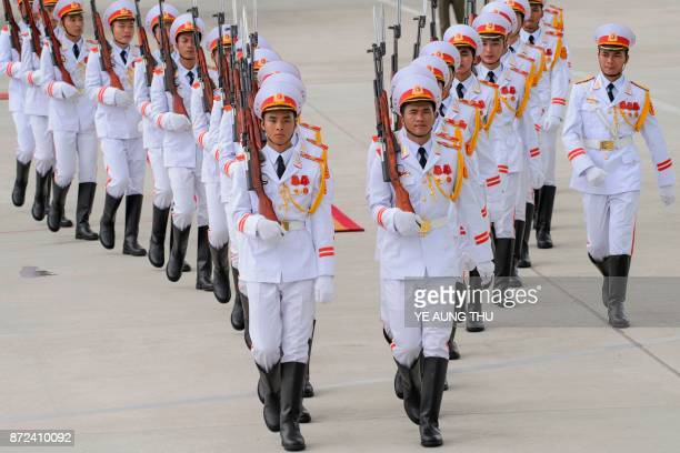 TOPSHOT Members of a Vietnamese honour guard march during the arrivals of leaders at the international airport ahead of the AsiaPacific Economic...