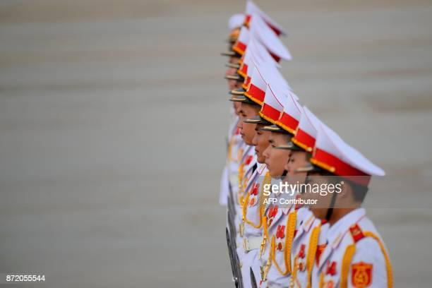 TOPSHOT Members of a Vietnamese honour guard stand at attention during the arrivals of leaders at the international airport ahead of the AsiaPacific...