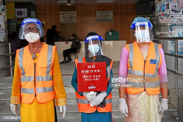 Members of a voluntary organization called Brihannala pose for a picture in front of the hospital. They provide services to patients at Dhaka Medical...