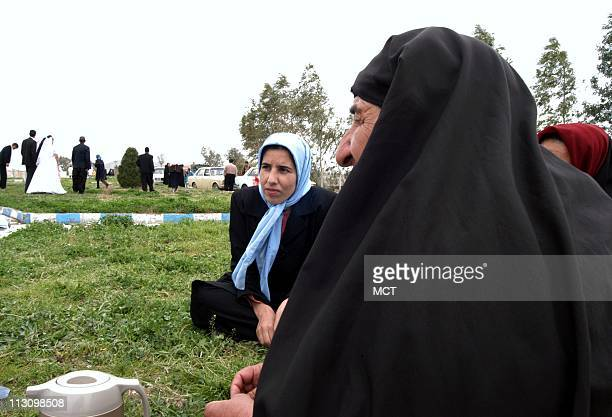 Members of a warstriken family in QasreShirin Iran spend a Saturday in Basij Park where a wedding takes place on February 15 2003 The park is on a...