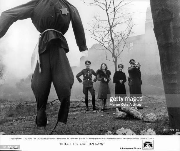 Members of Adolf Hitler's bunker Julian Glover Doris Kunstmann Ann Lynn Simon Ward and Sheila Gish partake in some target practice in a scene from...