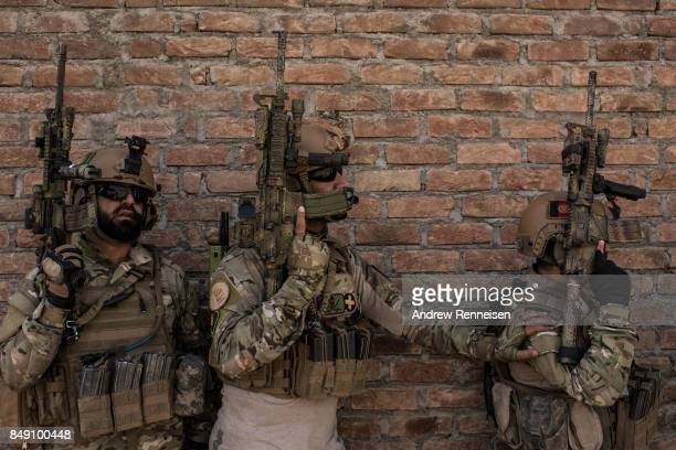 Members of Afghanistan's Crisis Response Unit 222, an Afghan Special Police Unit, participate in a training slowed down for the media on September 7,...