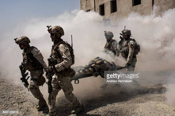 Members of Afghanistan's Crisis Response Unit 222 an Afghan Special Police Unit participate in a training slowed down for the media on September 7...
