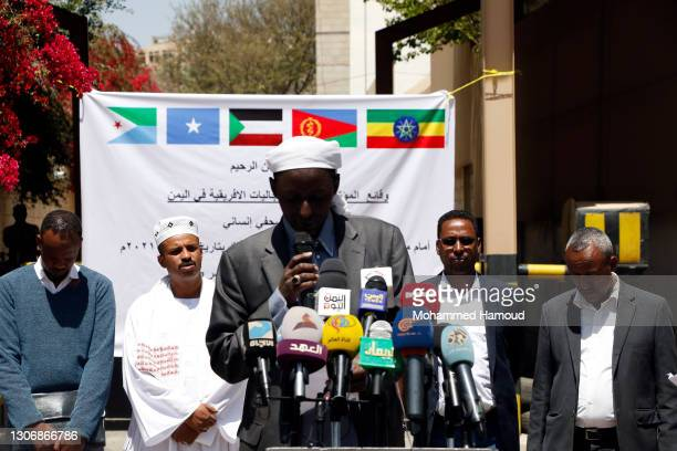 Members of African communities stage a gathering and conference outside the International Organization for Migration on March 13, 2021 in Sana'a,...