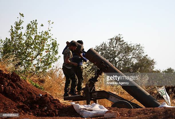 Members of Ahrar ashSham group in the Army of Conquest make preparations before they attack on the two villages of alFoua and Kefraya near Idlib...
