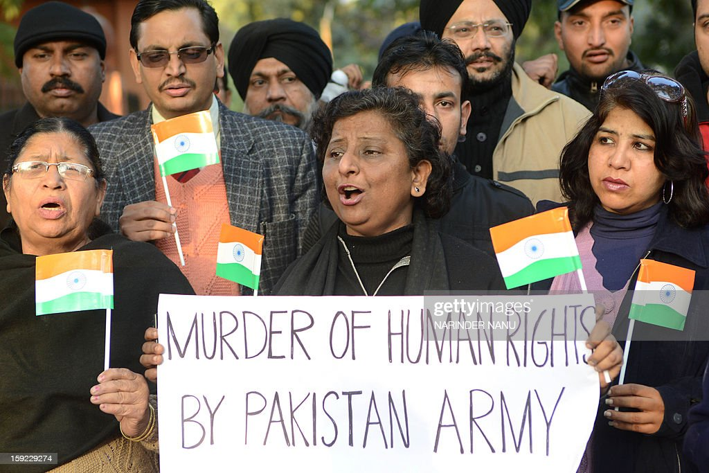 Members of Akhil Bhartiya Human Rights organisation (ABHRO) hold placards during a protest against the death of of Indian soldiers Lance Naik Hemraj and Sudhakar Singh in Amritsar on January 10, 2013. India summoned Pakistan's envoy in New Delhi Wednesday to protest the killing of two soldiers in a border clash, but warned against any escalation, after apparent tit-for-tat skirmishes that have led to deaths on both sides. Two Indian soldiers died after a firefight erupted in disputed Kashmir on Tuesday as a patrol moving in fog discovered Pakistani troops about 500 metres (yards) inside Indian territory, according to the Indian army.