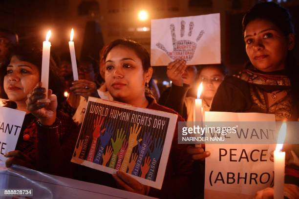 Members of Akhil Bhartiya Human Rights organization hold lit candles on the eve of World Human Rights Day at the IndiaPakistan Wagah border in India...