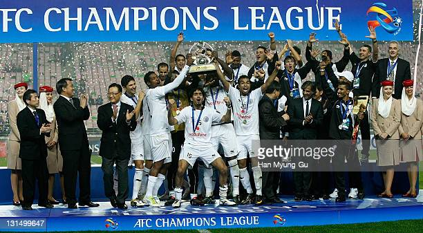 Members of Al Sadd of Qatar receives the Tropy during the awards ceremony of 2011 AFC Champions League Final Match between Jeonbuk Hyundai Motors of...