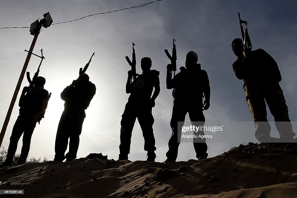 Members of al-Aqsa Martyrs' Brigades armed wing of the Palestinian Al Fatah Movement participate in a military training exercise in Rafah, Gaza on March 25, 2015.
