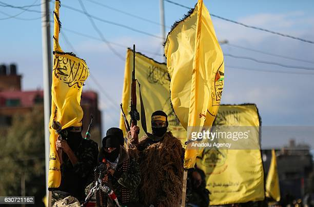 Members of AlAqsa Martyrs Brigades armed wing of the Palestinian Fatah movement march in the streets during the celebrations of the 51st foundation...