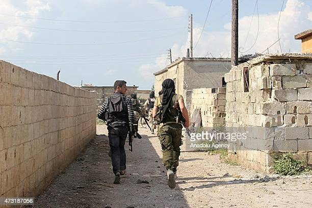 Members of alFatah forces are seen before attacking on Syrian regime forces in the town of Jisr alShughur in Idlib Syria on May 13 2015 Syrian regime...