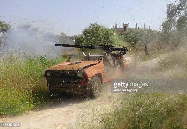 Members of alFatah forces attack on Syrian regime forces' located in the al Mastumah village of Idlib Syria on May 17 2015