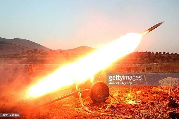 Members of alFatah forces attack on Syrian regime forces with missiles at Tal Elias in Jisr alShughur District of Idlib Syria on July 28 2015