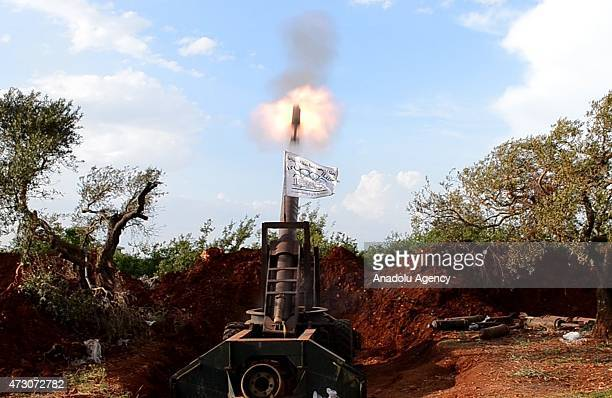Members of alFatah forces fire artillery as they attack on Syrian regime forces' Maaret al Bleyt military check point located on the AleppoLattakia...