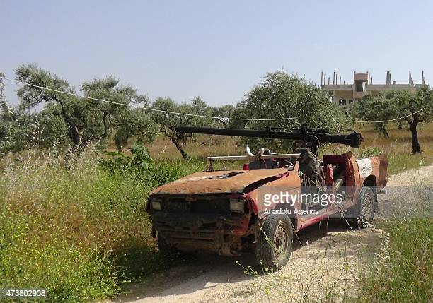 Members of alFatah forces make preparations before they attack on Syrian regime forces' located in the al Mastumah village of Idlib Syria on May 17...