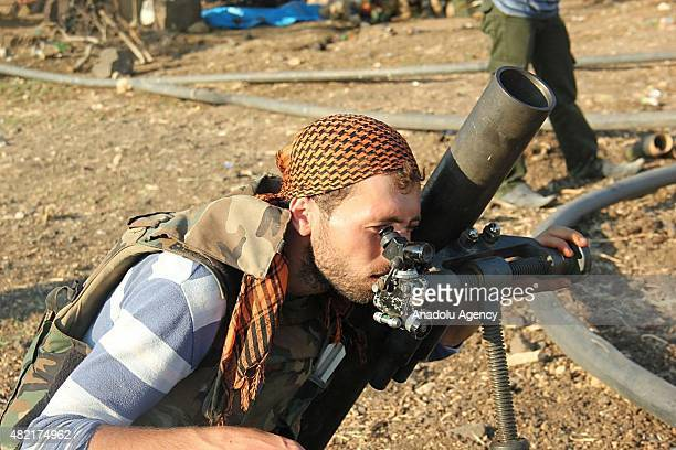 Members of alFatah forces make preparations before they attack on Syrian regime forces' at Tal Elias in Jisr alShughur District of Idlib Syria on...