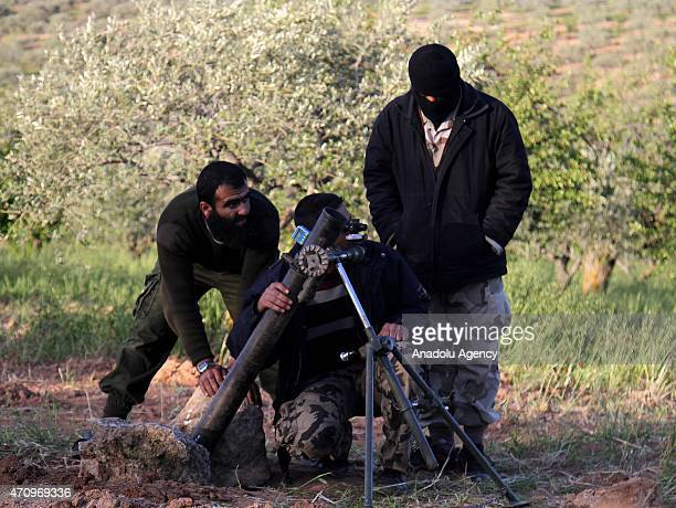 Members of alFatah forces prepare artillery as they attack the regions where the Assad regime forces are located in the town of Jisr alShughur in...