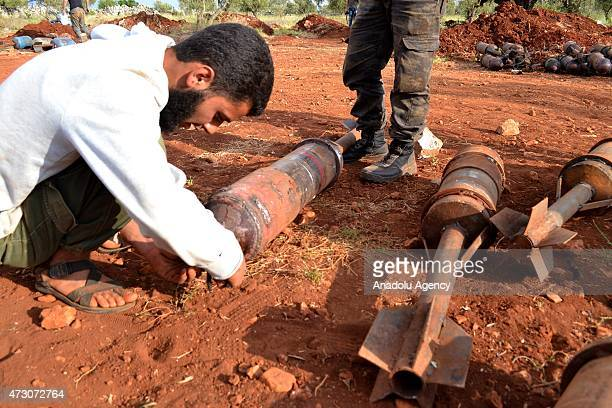 Members of alFatah forces prepare artillery before they attack on Syrian regime forces' Maaret al Bleyt military check point located on the...