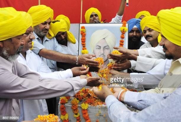 Members of All India AntiTerrorist Front pay floral tribute to ShaheedEAzam Bhagat Singh on the occasion of his 110th birth anniversary on September...