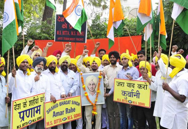 Members of All India AntiTerrorist Front raise patriotic slogans and pay tributes to ShaheedEAzam Bhagat Singh on the occasion of his 110th birth...