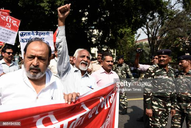 Members of All India Central Council of Trade Unions protest outside Nirman Bhawan against the Metro fare hike on October 23 2017 in New Delhi India