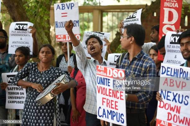 Members of All India Democratic Students' Organisation and various other groups protest against ABVP for allegedly indulging in violence at the...