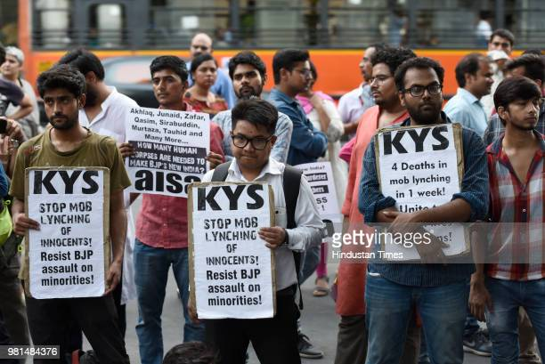 Members of All India Students Association hold placards as they protest against the mob lynchings in the country at Parliament street on June 22 2018...