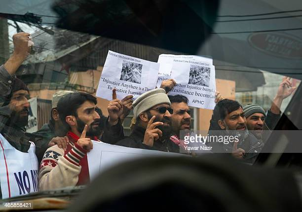 Members of All Parties Hurriyat Conference a Kashmir resistance group hold banners and placards during a protest against the Indian army's Pathribal...